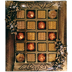 Exotic Collection of Diya Candles along with Lip-Smacking Handmade Chocolate Assortments