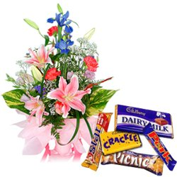 Seasonal Flowers Arrangement with Assorted Cadburys Chocolate