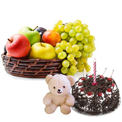 Outstanding Gift Hamper of Fruits Basket with Black Forest Cake and Small Teddy with Candles
