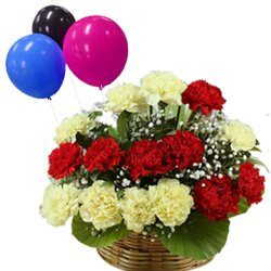 Sentimental Surprise Mixed Carnations in a Basket tied with Balloons