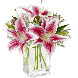 Special display of Pink Lilies in Glass Vase