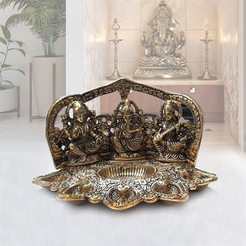 Attractive Metallic Diya with Ganesh, Lakshmi N Saraswati Idol