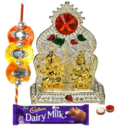 Silver Plated Mandap with Golden Ganesh Laxmi Idol and Cadbury Dairy Milk Chocolate with Rakhi and Roli Tilak Chawal
