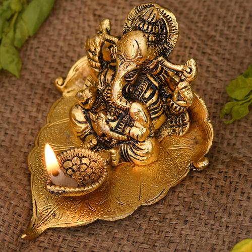 Auspicious Ganesha on Leaf with Diya