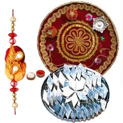 Trendsetting Selection of Haldirams Kaju Katli and Pooja Thali with Rakhi, Roli Tilak and Chawal