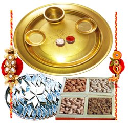 Impressive Rakhi Special Present of Decorative Gold Plated Thali, Yummy Kaju Katli and Dry Fruits with 2 free Rakhi Roli Tilak and Chawal for your Dear Brother