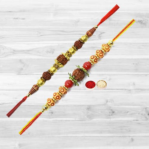 Fashionable One Pair of Rudraksha Rakhi along with free Roli Tika and Chawal for Cute Brother