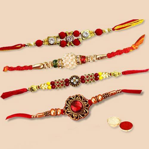 Gorgeous Set of 4 pc. Captivating Rakhi with free Roli Tilak, and Chawal for your Precious Brother on the Occasion of Rakhi