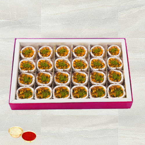 Kaju Pista Premium Sweets from Haldiram with free Roli Tilak and Chawal.